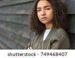 beautiful mixed race african... | Shutterstock . vector #749468407