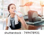young sport asian woman...   Shutterstock . vector #749478931