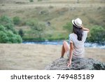 young woman tourist is sitting... | Shutterstock . vector #749485189
