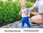 first steps of cute little... | Shutterstock . vector #749502439