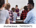 portrait of smiling teenage... | Shutterstock . vector #749503471