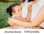 young unrecognizable mother... | Shutterstock . vector #749523481