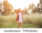 happy freedom in sunrise nature | Shutterstock . vector #749526061