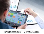 business colleagues working and ... | Shutterstock . vector #749530381