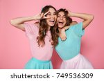 two happy young woman in... | Shutterstock . vector #749536309