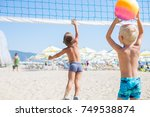 two young boys playing beach...   Shutterstock . vector #749538874