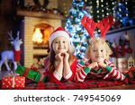 children at christmas tree and... | Shutterstock . vector #749545069