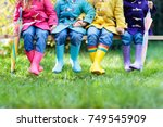 group of kids in rain boots.... | Shutterstock . vector #749545909