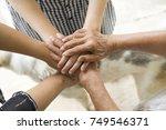 concept of teamwork  aging... | Shutterstock . vector #749546371