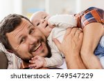 family  parenthood and people... | Shutterstock . vector #749547229
