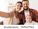 family  parenthood and people... | Shutterstock . vector #749547961