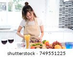 woman cooking food in kitchen...   Shutterstock . vector #749551225