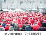 people dressed up as santas...   Shutterstock . vector #749555059