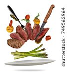 flying beef steaks with grilled ... | Shutterstock . vector #749562964