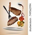 flying beef steaks with grilled ... | Shutterstock . vector #749562994