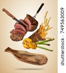 flying beef steaks with grilled ... | Shutterstock . vector #749563009