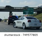 Small photo of DENTON, TEXAS—SEPTEMBER 2017: Police cars respond to a road emergency under an overpass in Denton, Texas.