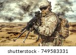 machine gunner in the desert in ...   Shutterstock . vector #749583331