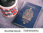 canadian passport sitting next... | Shutterstock . vector #749593591