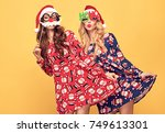 christmas new year. two young... | Shutterstock . vector #749613301