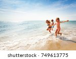 happy friends running along... | Shutterstock . vector #749613775