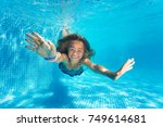 portrait of preteen girl diving ... | Shutterstock . vector #749614681