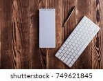 the white open notepad and... | Shutterstock . vector #749621845