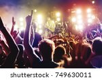 concert crowd. silhouettes... | Shutterstock . vector #749630011