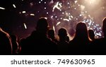 crowd watching fireworks | Shutterstock . vector #749630965