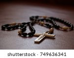 rosary on a leather red sofa | Shutterstock . vector #749636341