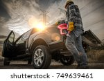 Contractor Field Research Future Construction Site. Field Work. Caucasian Worker and His Company Pickup Truck - stock photo