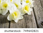 winter daffodils on weathered... | Shutterstock . vector #749642821