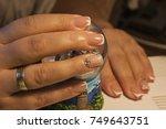 maiden hands. the girl's... | Shutterstock . vector #749643751