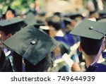 graduates wearing black  hats... | Shutterstock . vector #749644939