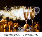two champagne glasses against... | Shutterstock . vector #749686075