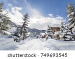 alpine homes at the foot of... | Shutterstock . vector #749693545