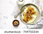 oat porridge with caramelized... | Shutterstock . vector #749703334