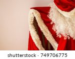 the red outfit of santa claus... | Shutterstock . vector #749706775