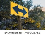 two directional yellow arrow... | Shutterstock . vector #749708761