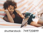 beautiful relaxed black female... | Shutterstock . vector #749720899