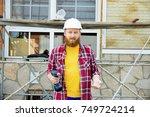 portrait of construction worker | Shutterstock . vector #749724214