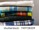 stack of woolen checked... | Shutterstock . vector #749728339