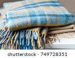 stack of woolen checked... | Shutterstock . vector #749728351