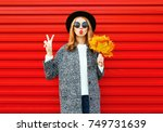 fashion autumn young woman with ... | Shutterstock . vector #749731639