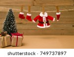 Stock photo santa s clothes hanging on the line preparing for christmas eve 749737897