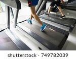gym treadmill closeup with man... | Shutterstock . vector #749782039