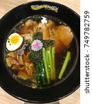 Small photo of Bangkok, Thailand - October 20, 2017: Japanese cuisine, Ramen soup with chashu pork, egg, chives and seaweed on the table at Oishi Ramen. Oishi Ramen restaurant is a famous restaurant in Thailand