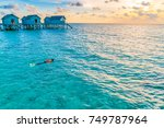 snorkeling in tropical maldives ... | Shutterstock . vector #749787964