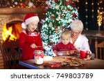 grandmother and children baking ... | Shutterstock . vector #749803789