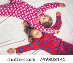 girls in pajamas sleep in bed ... | Shutterstock . vector #749808145